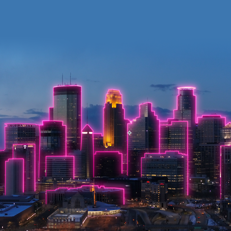 Minneapolis skyline at night outlined by magenta beams