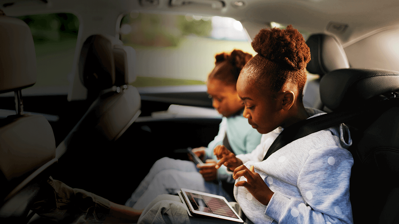 Kids in car with devices