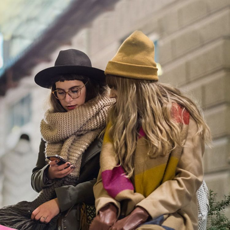 Two women looking at a phone together