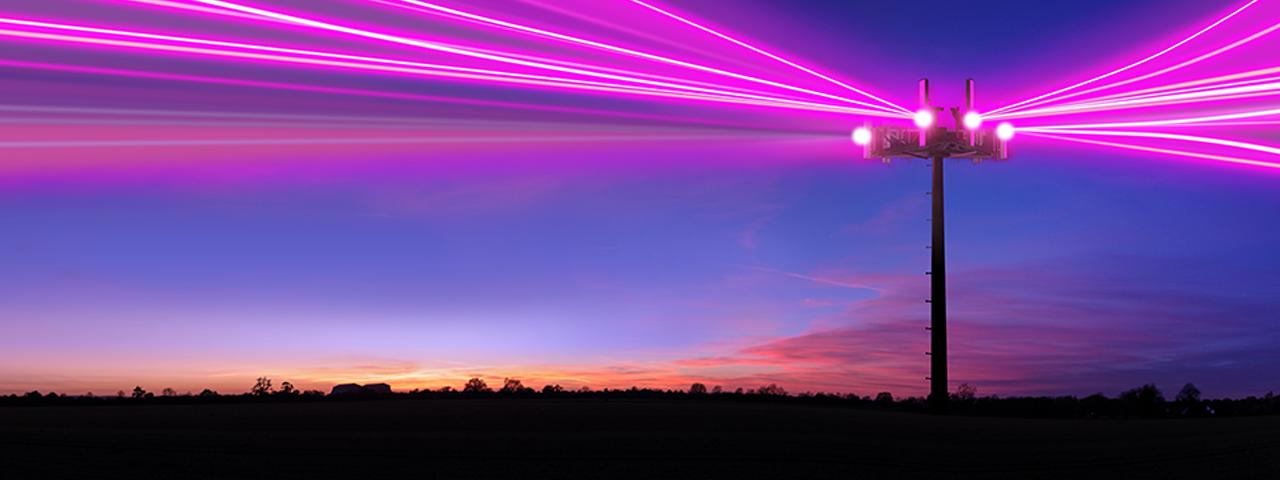 5G laser beams at dusk
